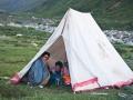 yak man and tent in Tsurphu trek