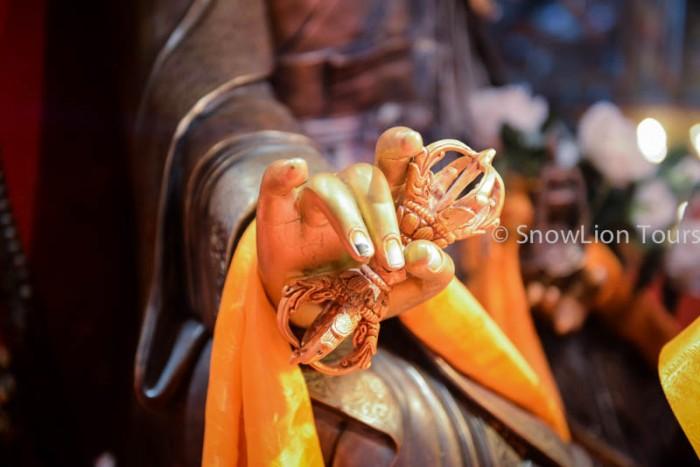 the vajra in Budda's hand
