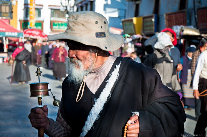 A Tibetan elderly pilgrim walking around Jokhang Temple