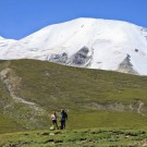 two of our customers poses a front of Mt.Amnye Machen during trekking around the snow mountain in Amdo Tibet