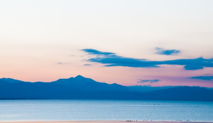 Shores of Manasarovar lake during the sunrise