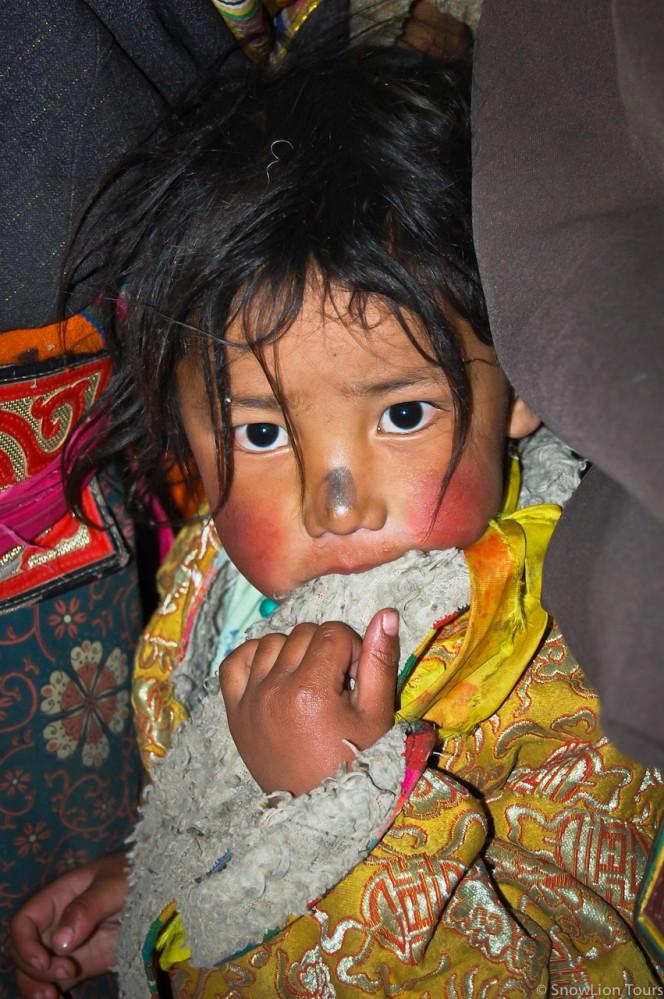 Tibetan kid just blessed in Sera Monastery