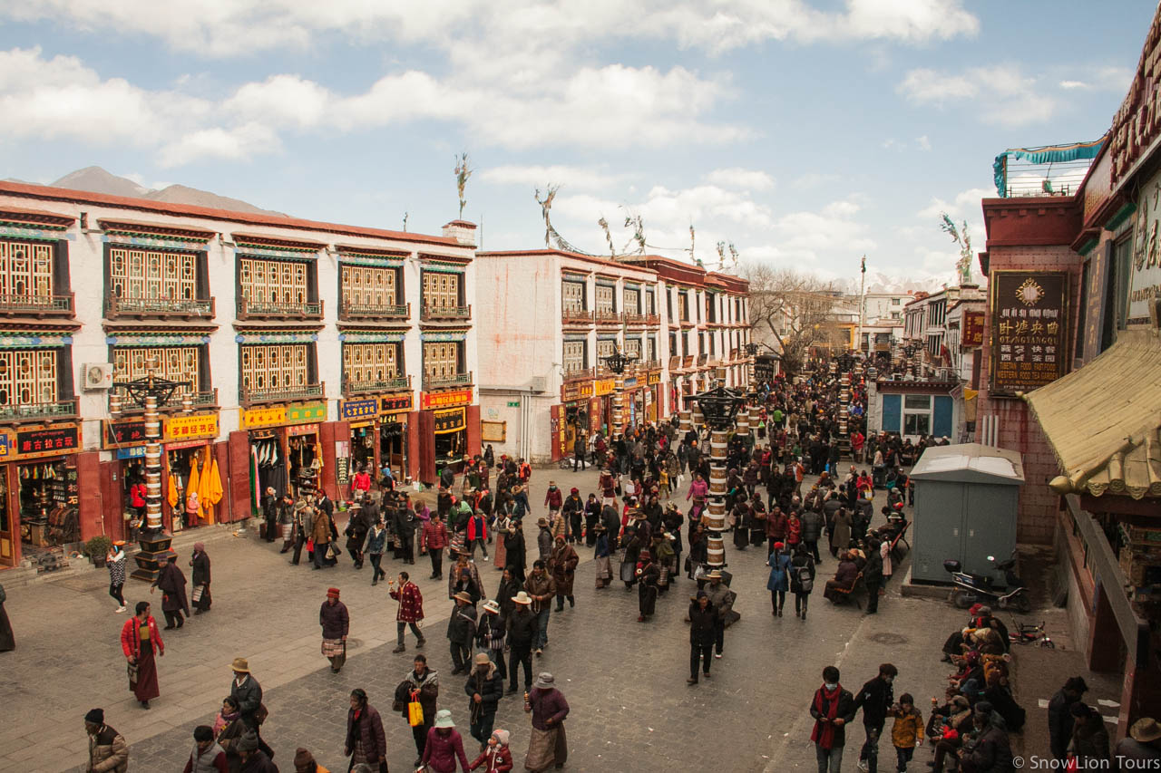 Barkhor Street in Lhasa, local Tibetan circumambulating  around the holy temple of Jokhang.