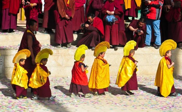 Little monks during Molam Prayer Festival in Tongren